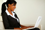 Beautiful business black woman reading on laptop
