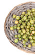 Green gooseberry on wicker mat isolated on white