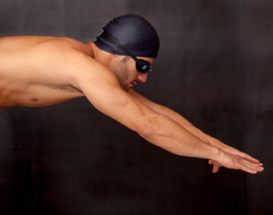 Male swimmer diving
