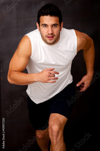 Competitive man running