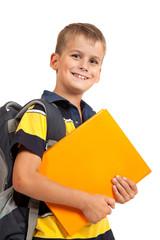 Boy holding books. Back to school