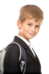 Schoolboy sitting on books. Back to school