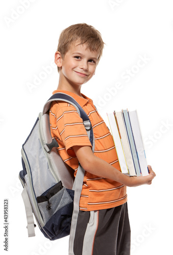Boy holding books. Back to school