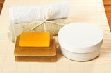 soaps, cream and towels ready for spa treatments