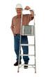 Smiling construction worker holding ladder