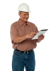 Aged architect using tablet pc