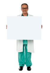 Senior medical professional displaying banner ad
