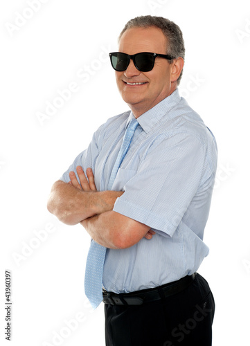 Confident male executive wearing sunglasses
