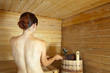 woman taking  steam bath in sauna