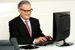 Casual businessman typing on keyboard