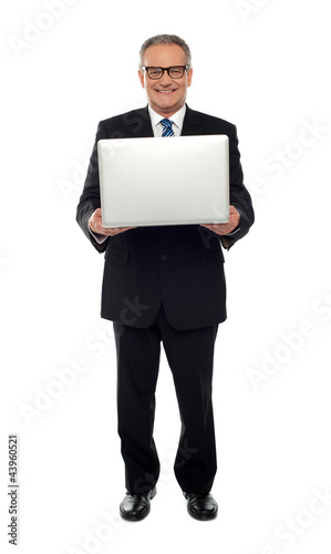 Experienced business person holding laptop