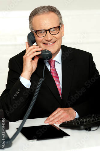 Smiling aged man communicating with his client