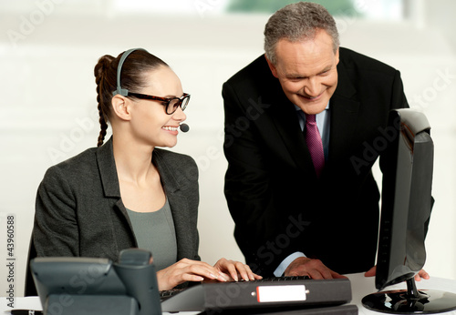 Corporate team working together on computer