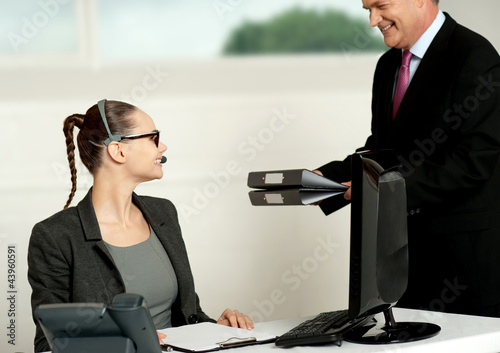 Business team of two working in office