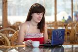 woman using  laptop at resort
