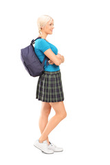 Full length portrait of a female student standing in profile