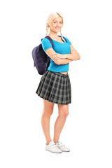 Full length portrait of a female student standing with crossed h