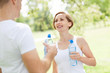 Couple drinking water after exercise