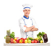 Male chef with fruits and vegetables on table