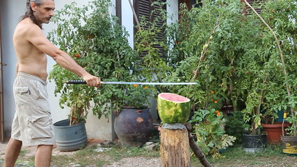 cutting up a watermelon with a samurai sword