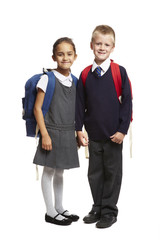 8 year old school boy and girl on white background