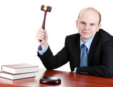 wooden gavel in hand and books