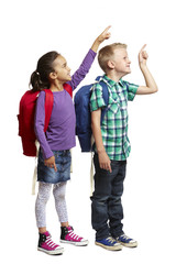 8 year old school boy and girl with backpacks pointing on white