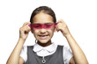 8 year old school girl with pink ruler on white background
