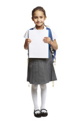 8 year old school girl with backpack and notepad on white backgr