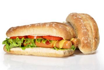 Perrito doble y bollos de pan.