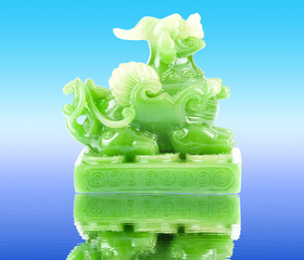 Green Pixiu on a white background, Chinese lucky animal mascot