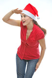 Young woman in Christmas hat looking into distance