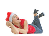 Happy woman in Christmas hat laying on floor and looking on copy