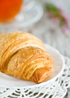 Croissant with cup of tea