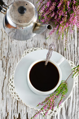 Cup of coffee and heather