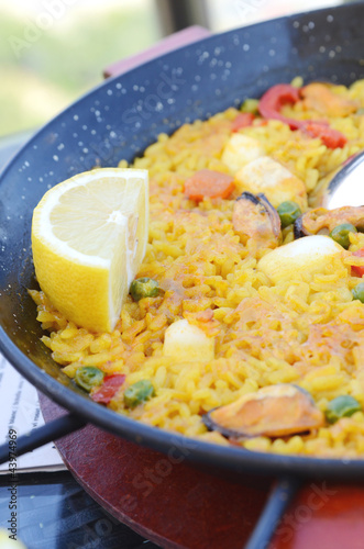 Spanish paella with seafood in a pan