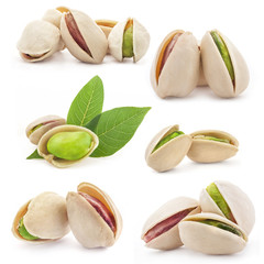 Pistachios nuts with a leaf, isolated on white background