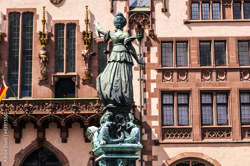 statue of lady justice in front of the roemer in frankfurt