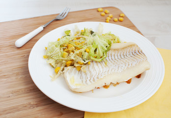 White fish fillet with savoy cabbage and corn