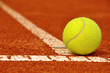 Tennis ball on a tennis clay court - 43980546