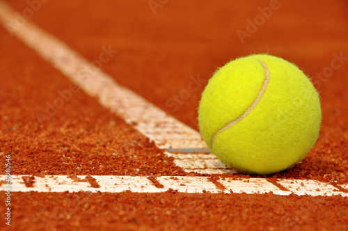 canvas print picture Tennis ball on a tennis clay court