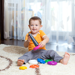 Child playing with toy at home.