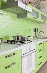 Modern kitchen interior with green decoration