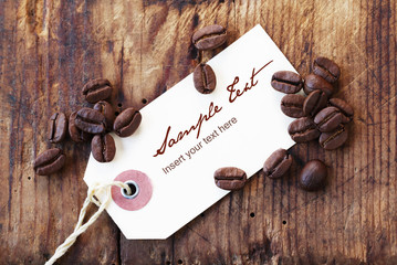 Blank Label with Coffee Beans on a Wooden Background