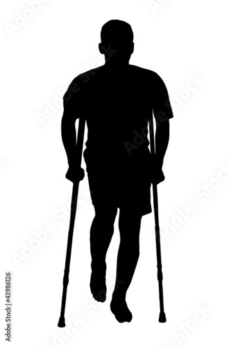 A silhouette of an injured man on crutches