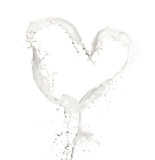 Heart symbol made of milk splashes, isolated on white background