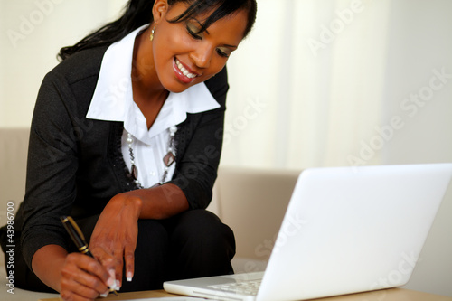 Pretty businesswoman on black suit working