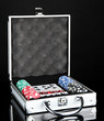 Poker set in metallic case isolated on black background