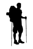 A silhouette of a hiker with backpack holding hiking poles