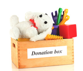 Donation box with children toys isolated on white